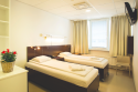One of the lovely patient rooms where a companion can stay with the patient during their time in the hospital